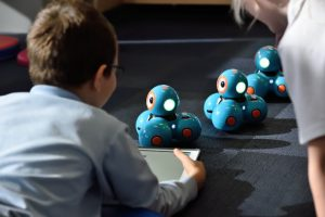 kid playing with robot