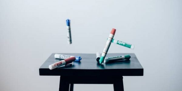 markers on a table